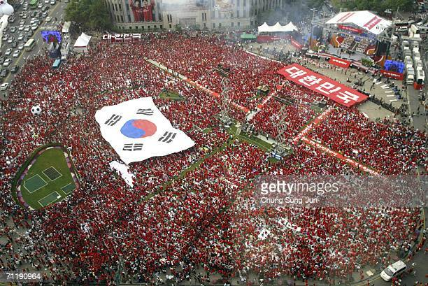 South Korean soccer fans carry a huge national flag as they gather to watch the public viewing of the FIFA World Cup Germany 2006 G match between...