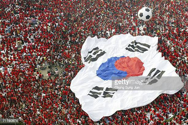 South Korean soccer fans carry a huge national flag as they gather to watch the public viewing of the FIFA World Cup Germany 2006 group G match...