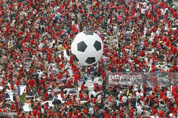 South Korean soccer fans carry a soccer ball as they gather to watch the public viewing of the FIFA World Cup Germany 2006 group G match between...