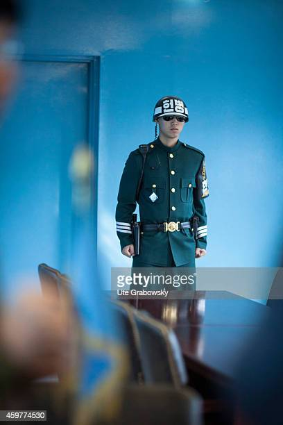 South Korean soldier at the Joint Security Area guarding the exit of the blue building leading to the North Korean side on November 01 in Panmunjom...