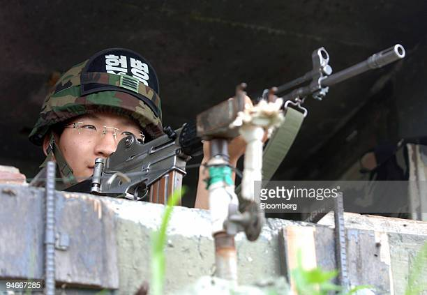 South Korean soldier in an observation post keeps guard over the demilitarized zone separating North and South Korea in Paju South Korea on Friday...