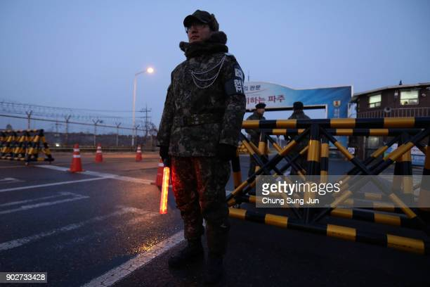 South Korean soldier patrols the road connecting South and North Korea at the Unification Bridge near the Demilitarized zone separating South and...