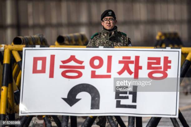 South Korean soldier patrols the road connecting South and North Korea at the Unification Bridge near the Demilitarized Zone on February 7 2018 near...