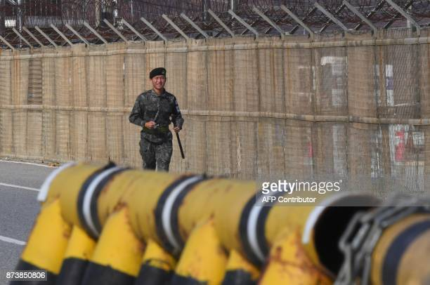 A South Korean soldier runs along a military fence on the road leading to the truce village of Panmunjom at a South Korean military checkpoint in the...