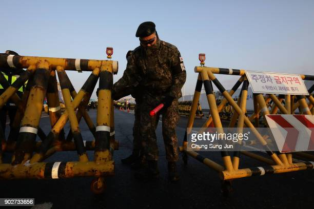 South Korean soldier sets barricades on the road connecting South and North Korea at the Unification Bridge near the Demilitarized zone separating...