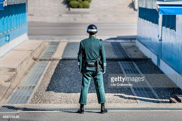 South Korean soldier standing at the military demarcation line separating North and South Korea within the Joint Security Area on November 01 in...