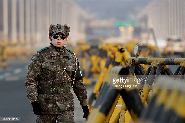 South Korean soldier stands at a military check point connecting South and North Korea at the Unification Bridge on February 11 2016 in Paju South...
