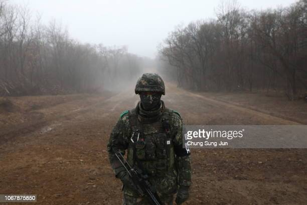 South Korean soldier stands at the Military Demarcation Line between South and North Korea a site of fierce battles in the 195053 Korean War to build...
