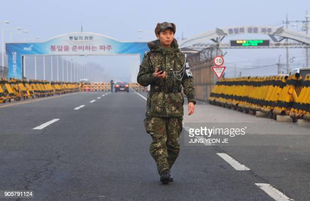 A South Korean soldier stands guard at a military checkpoint leading to the border truce village of Panmunjom in Paju on January 17 2018 Officials...