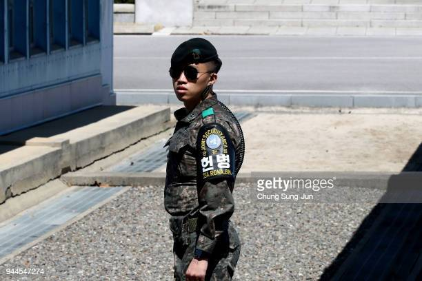 South Korean soldier stands guard at the border village of Panmunjom between South and North Korea at the Demilitarized Zone on April 11 2018 in...
