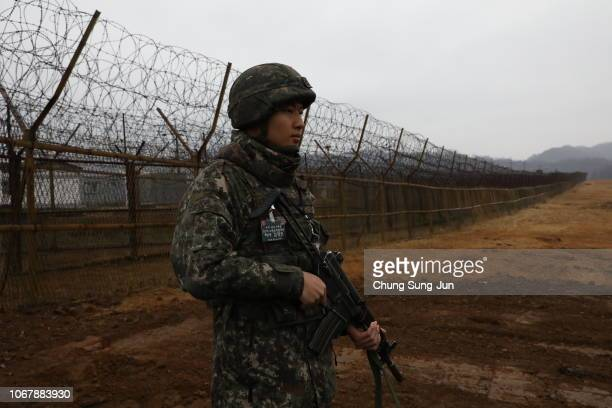 South Korean soldier stands guard at the gate of the Demilitarized Zone on December 3, 2018 in DMZ, South Korea. The two Koreas connected the...