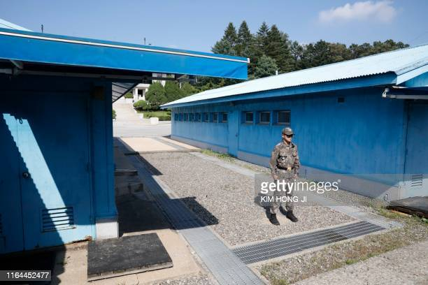 A South Korean soldier stands guard at the truce village of Panmunjom inside the Demilitarized Zone separating the two Koreas on August 28 2019