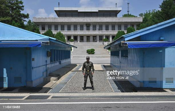 South Korean soldier stands guard before the Military Demarcation Line during a regular media tour at the border truce village of Panmunjom in the...
