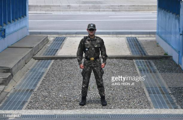 A South Korean soldier stands guard before the Military Demarcation Line during a regular media tour at the border truce village of Panmunjom in the...