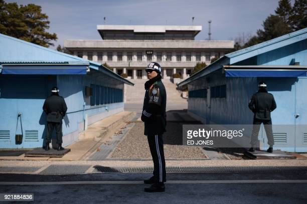 South Korean soldier stands guard before the military demarcation line and North Korea's Panmun Hall in the truce village of Panmunjom within the...