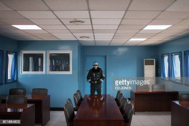 A South Korean soldier stands guard in a pavillion spanning the military demarcation line in the truce village of Panmunjom within the Demilitarized...