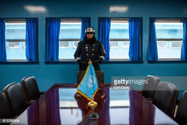 South Korean soldier stands guard inside a Joint Security Area conference room at the border village of Panmunjom in the Demilitarized Zone between...