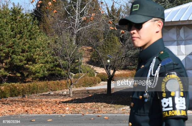 A South Korean soldier stands guard near the spot where a North Korean soldier crossed the border line two weeks ago at the truce village of...