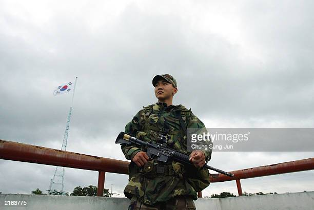 South Korean soldier stands guard on July 22 2003 at Daesung village in the demilitarized zone South Korea Politicians and diplomats are speculating...