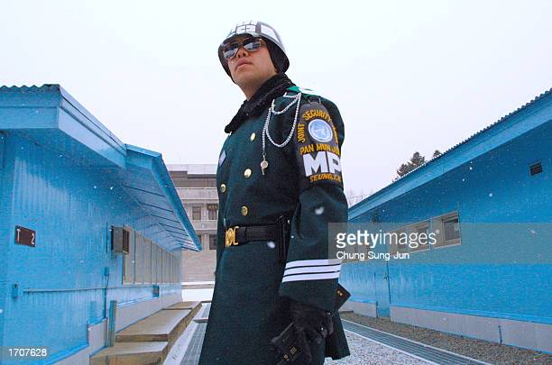 South Korean soldier stands guard on the space that separates the two Koreas January 3 2002 at the border village of the Panmunjom north of Seoul...