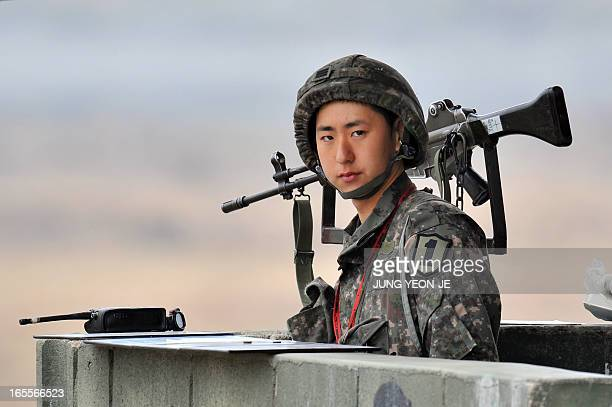 A South Korean soldier stands on a military guard post near the demilitarized zone dividing the two Koreas in the border city of Paju on April 5 2013...