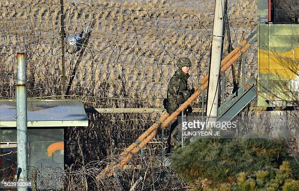 A South Korean soldier walks up to a guard post at a military guard area in the border city of Paju near the Demilitarized zone dividing the two...