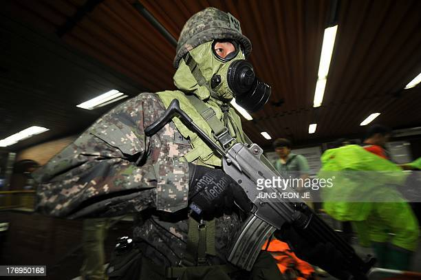 A South Korean soldier wearing a gas mask moves to a position during an antiterror drill on the sidelines of South KoreaUS joint military exercise...