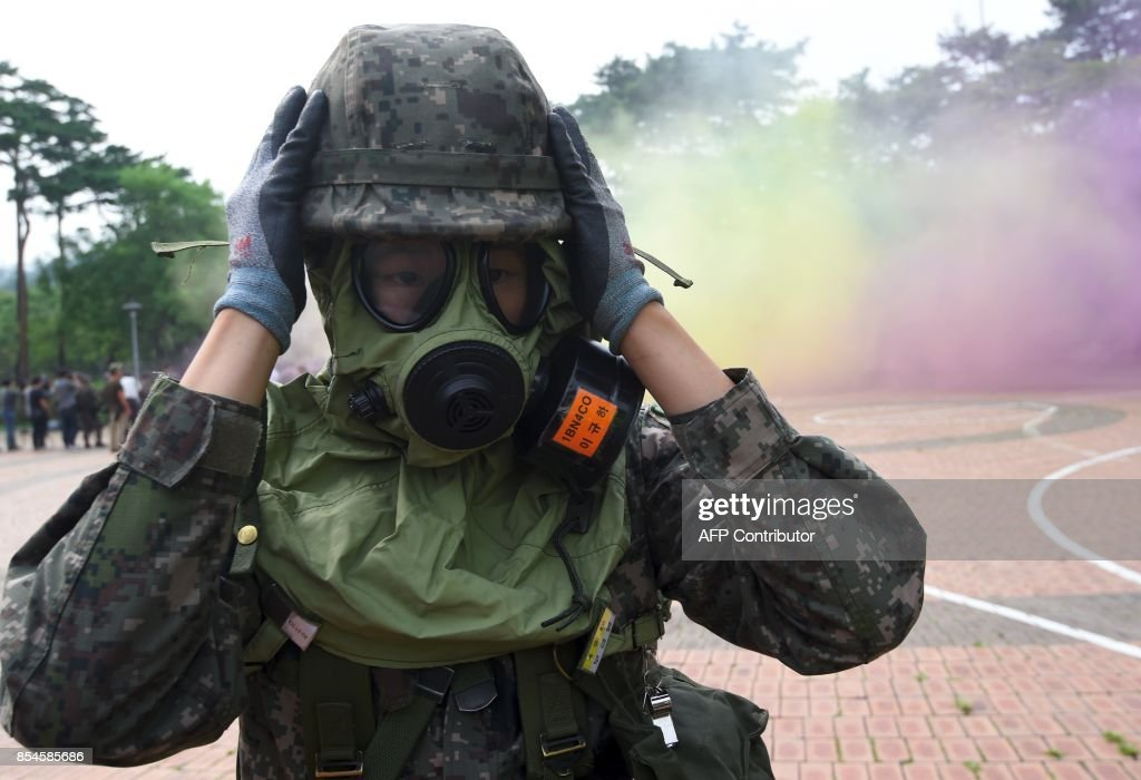 A South Korean soldier wears a gas mask during a decontamination training at a stadium in Seoul on September 27, 2017. The training is designed to train their systems and capabilities to increase their preparedness to respond to chemical, biological and nuclear threats. Yeon-Je