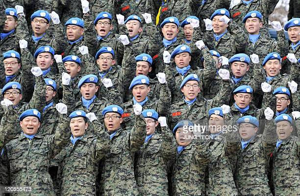 South Korean soldiers cheer up during a dispatching ceremony of the South Korean peacekeepers at an army base in Incheon, west of Seoul, on February...