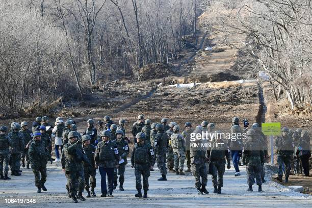 South Korean soldiers gather at Arrowhead Ridge a site of battles in the 195053 Korean War as a tactical road is built across the military...