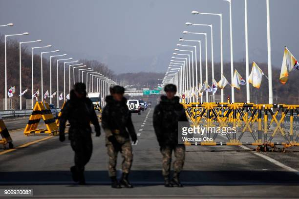 South Korean soldiers guard at the entrance of Unification Bridge which is the border of Civilian Controled Zone before the torch relay for...