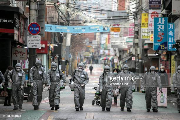 South Korean soldiers, in protective gear, disinfect the Eunpyeong district against the coronavirus on March 04, 2020 in Seoul, South Korea. The...