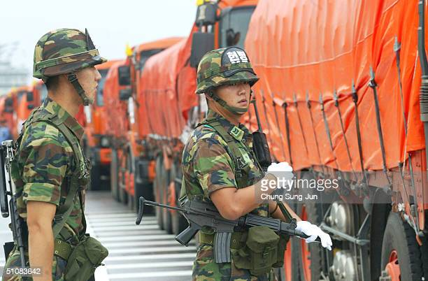 South Korean soldiers inspect trucks transporting rice to North Korea July 20 2004 in Paju near the Demilitarized Zone north of the interKorean...
