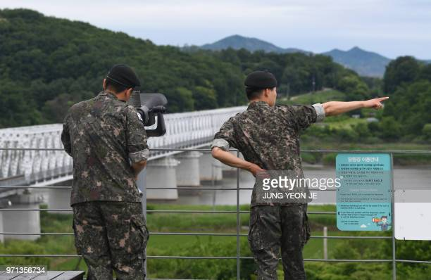 South Korean soldiers look through binoculars at a viewing deck of Imjingak peace park near the Demilitarised Zone dividing the two Korea's in the...