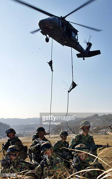 South Korean soldiers lower themselves from a helicopter during a military exercise February 6 2003 in Yeonki south of Seoul South Korea North Korea...