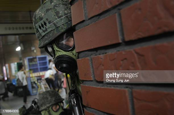 South Korean soldiers participate in an antiterror and antichemical drill session held as part of the Ulchi Freedom Guardian exercise on on August 20...