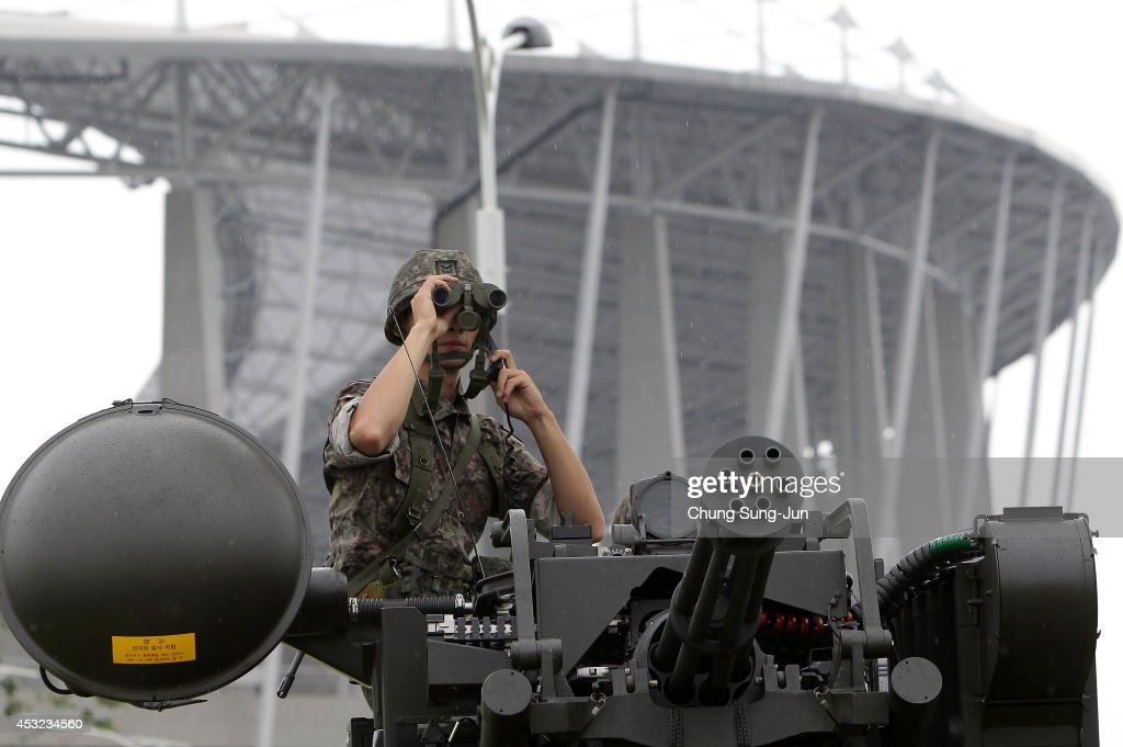 South Korean soldiers participate in an anti-terror drill held by Incheon Metropolitan City around Incheon Asiad Main Stadium on August 6, 2014 in Incheon, South Korea. The military members, firefighters and police officers took part in this drill exercise simulating possible terror attacks at the Incheon Asian Game.