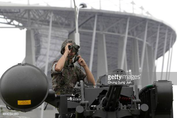 South Korean soldiers participate in an anti-terror drill held by Incheon Metropolitan City around Incheon Asiad Main Stadium on August 6, 2014 in...