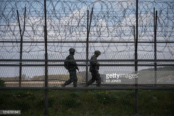 South Korean soldiers patrol along a barbed wire fence Demilitarized Zone separating North and South Korea on the South Korean island of Ganghwa on...