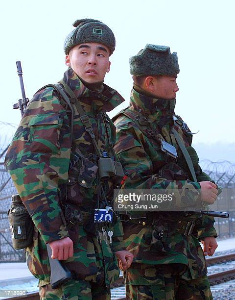 South Korean soldiers patrol inside the barbedwire fence at Imjinkak near the Demilitarized zone separating South and North Korea January 10 2003 in...