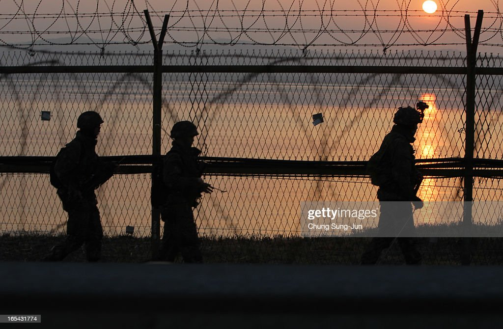South Korean soldiers patrol inside the barbed-wire fence near Dorasan on April 4, 2013 in Paju, South Korea. Still 400 South Koreans remain in the joint industrial park fearing they can not get back there once they return to South. In recent weeks North Korea has threatened to attack South Korea and U.S. military bases, with South Korean and American intelligence identifying what is believed to be an intermediate-range missile being moved by North Korea to its eastern coast, in preparation for a planned strike.