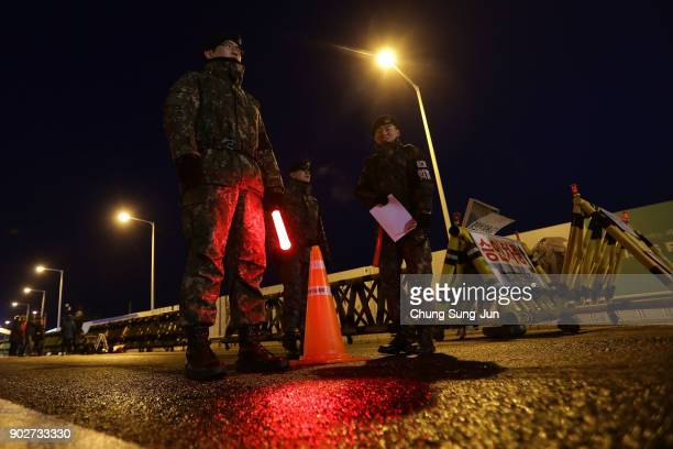 South Korean soldiers patrol the road connecting South and North Korea at the Unification Bridge near the Demilitarized zone separating South and...