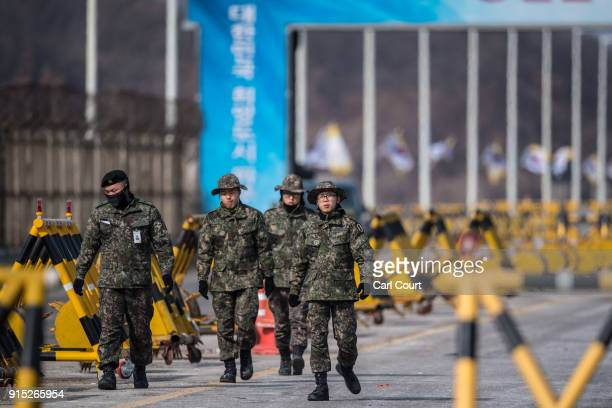 South Korean soldiers patrol the road connecting South and North Korea at the Unification Bridge near the Demilitarized Zone on February 7, 2018 near...