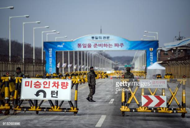 South Korean soldiers patrol the road connecting South and North Korea at the Unification Bridge near the Demilitarized Zone on February 7 2018 near...