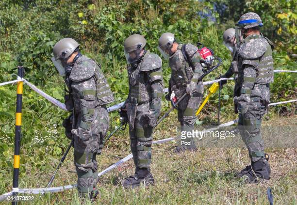 South Korean soldiers remove landmines inside of the Demilitarized Zone on October 2, 2018 in Cheorwon, South Korea. South and North Korea began...