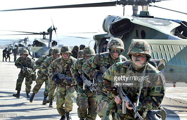 South Korean soldiers run during a military exercise February 6 2003 in Yeonki south of Seoul South Korea North Korea warned preemptive attacks on...