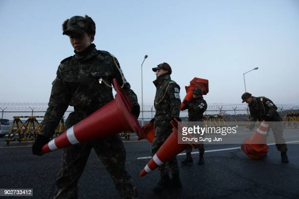 South Korean soldiers set barricades on the road connecting South and North Korea at the Unification Bridge near the Demilitarized zone separating...