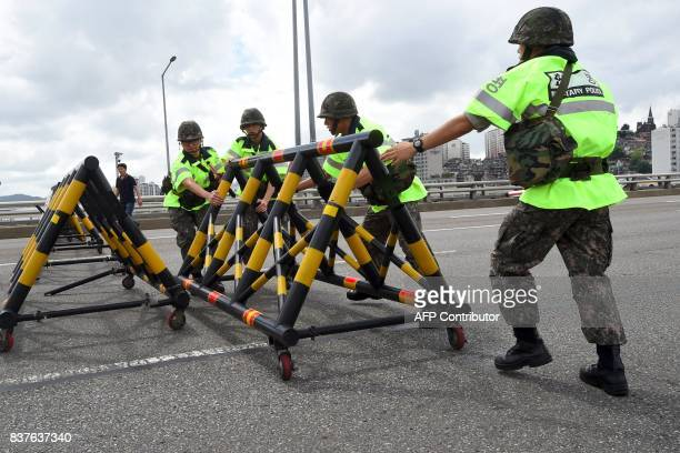 South Korean soldiers set up barricades on Hannam bridge during a regular defence drill against possible artillery attacks by North Korea in Seoul on...
