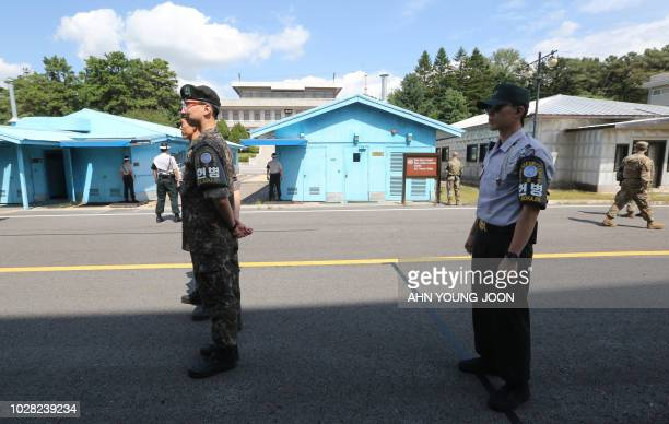 South Korean soldiers stand guard at the border village of Panmunjom in the Demilitarized Zone on September 7 2018 The leaders of the two Koreas will...