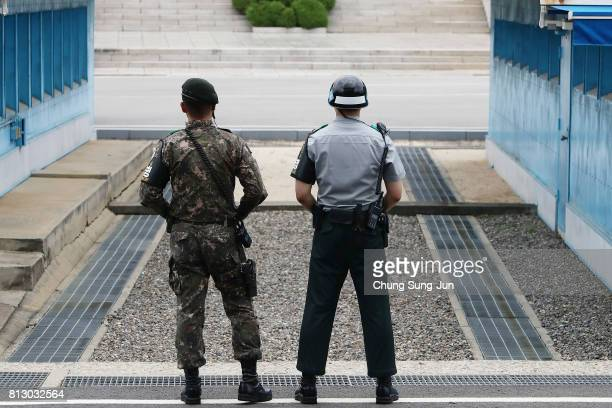 South Korean soldiers stand guard at the border village of Panmunjom between South and North Korea at the Demilitarized Zone on July 12 2017 in...